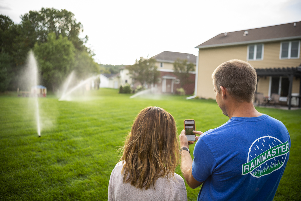 RainMaster irrigation technician with customer in Eau Claire, WI