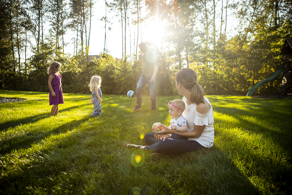Family in lawn with mosquito and tick control services