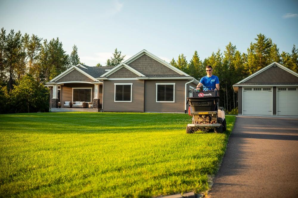Lawn team fertilizing a yard