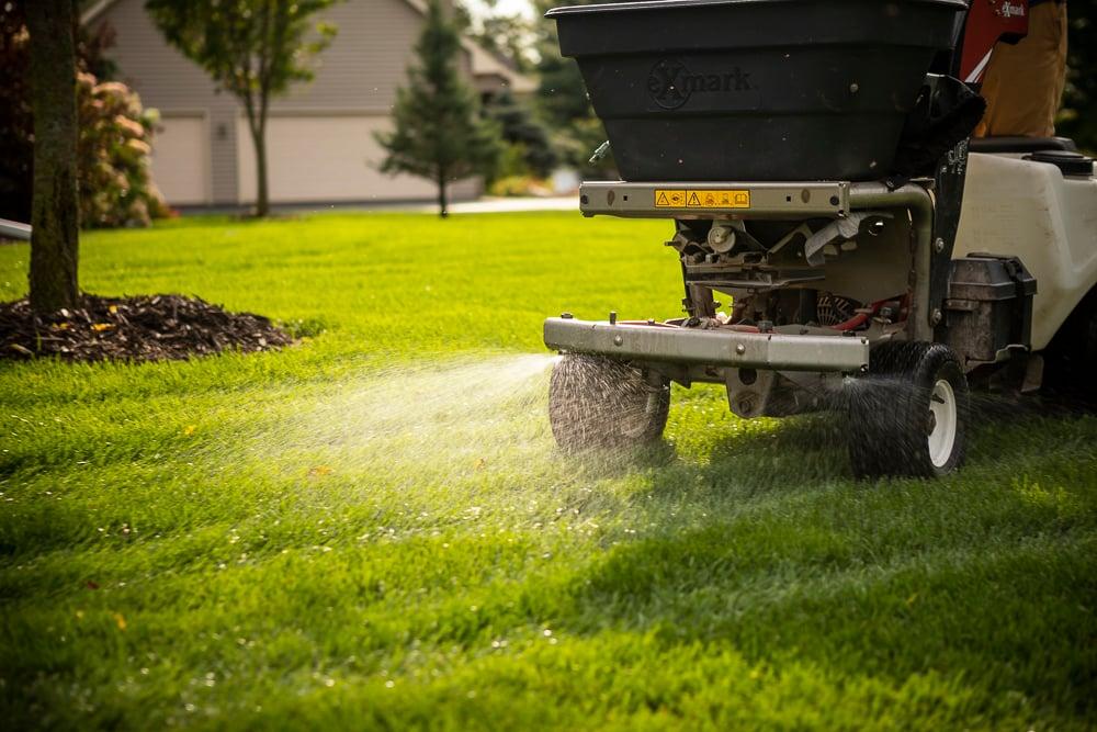 lawn team applying granular fertilizer