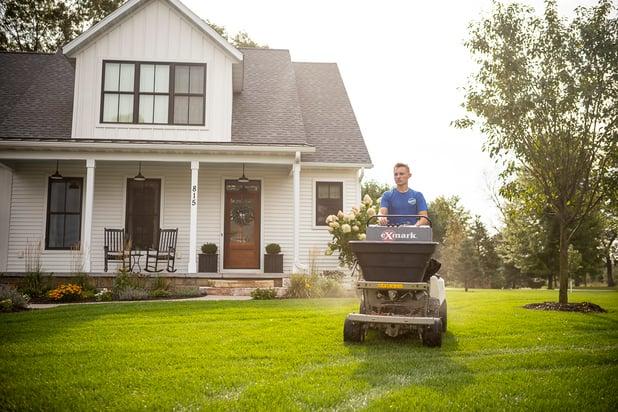 RainMaster lawn care technician treating lawn