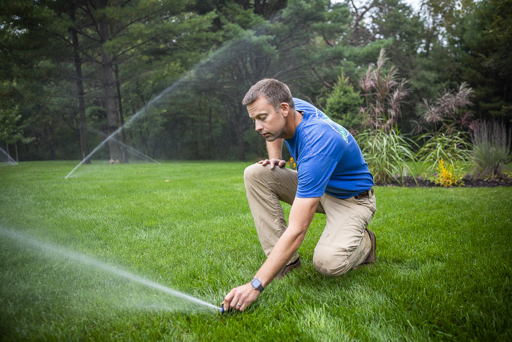 Irrigation technician inspecting sprinkler system